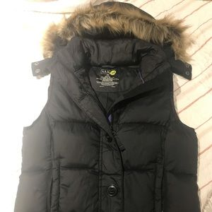 Puffer vest with removable hood.